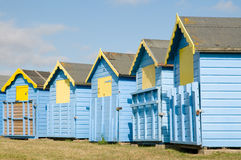 Blue and yellow beach huts Stock Image
