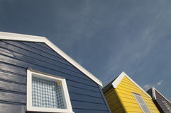 Blue and yellow beach huts Royalty Free Stock Photos