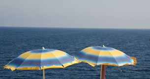 Blue and Yellow Beach Umbrellas Royalty Free Stock Image