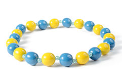 Blue and yellow beads. Isolated on white background Stock Photography