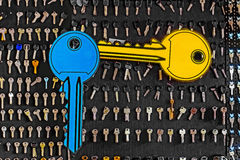 Blue and yellow big keys on a special wall with keys Stock Image