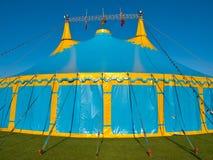 Blue and yellow big top circus tent. Close up of a  blue and yellow big top circus tent Royalty Free Stock Photos