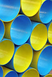 Blue and yellow big tubes, circles. Big blue and yellow circular tubes for storage of children's things Stock Photography