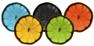 Blue yellow black green red lemons white background Royalty Free Stock Photo
