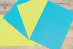 Blue and yellow blank sheets of paper Stock Photo