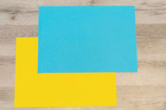 Blue and yellow blank sheets of paper Stock Images
