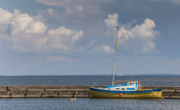 Blue and yellow boat on the Curonian Spit Stock Image