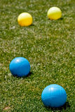 Blue and Yellow Bocce Balls in Green Grass Stock Photos