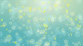 Blue yellow bokeh lights background. Glowing teal blue yellow background with floating bokeh lights stock video footage