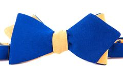 Blue and yellow bow tie isolated. Bow tie isolated on white background Royalty Free Stock Images