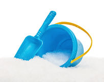 The blue yellow bucket and shovel which are filled up with snow Stock Image