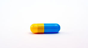 Blue-yellow capsule Stock Images