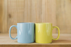 Blue and yellow ceramic coffee mug Stock Photos