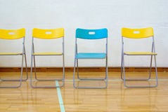 Blue on Yellow Chairs Stock Photography