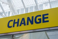 Blue and yellow change sign to change money. Close up royalty free stock photo