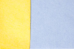 Blue and yellow cleaning rags. Abstract background Stock Photography