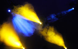 Blue and yellow colored light show over concert stage Royalty Free Stock Images