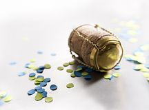 Blue and yellow confetti with cork. Blue and yellow confetti with champagne cork Royalty Free Stock Images