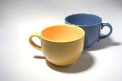 Blue an yellow cup. Bleu and yellow cup isolated on  white grey background Stock Photos