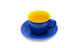 Blue and yellow cup and saucer. Royalty Free Stock Image
