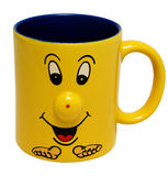 Blue yellow cup with smiling face , isolated on Stock Image