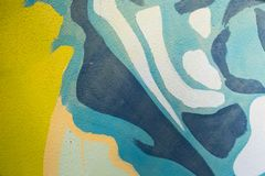 Blue and yellow details of a painted wall stock photo