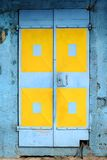Blue and yellow doors Stock Image