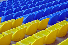 Blue and yellow empty stadium seats. Rows of blue and yellow empty stadium seats Royalty Free Stock Image