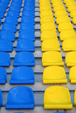 Blue and yellow empty stadium seats. Rows of blue and yellow empty stadium seats Stock Images