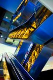 Blue and yellow escalators Stock Photography