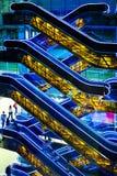 Blue and yellow escalators Stock Image