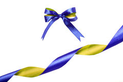 Blue-yellow fabric ribbon and bow. Isolated on white background Stock Photos