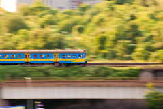 Blue and yellow fast electric train Stock Images
