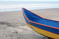 Blue and Yellow Fishing Boat on a Beach Royalty Free Stock Photo