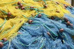Blue and yellow fishing net in the fishing harbor royalty free stock image