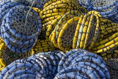 Blue and yellow fishing nets. Abstract industrial background, top view Royalty Free Stock Photography