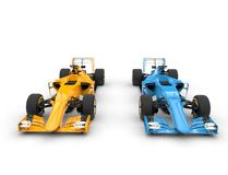 Blue and yellow formula one cars Stock Photography