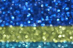 Blue and yellow glitter stock photography