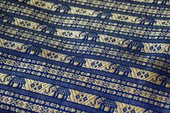 Blue yellow gold thai handmade silk pattern. Blue and yellow gold thai handmade silk pattern Royalty Free Stock Photos