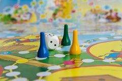 Blue, yellow and green plastic chips, dice and Board games for children.  royalty free stock images