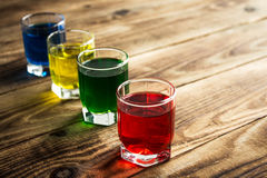 Blue yellow green red alcohol shot drinks Stock Photography