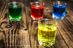 Blue yellow green red alcohol shot drinks royalty free stock image