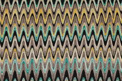 Blue, yellow and grey waves horizontal lines pattern fabric. As background Royalty Free Stock Image