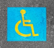 Handicapped parking sign paint on asphalt royalty free stock photography