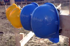 BLUE AND YELLOW HARD HAT Stock Images