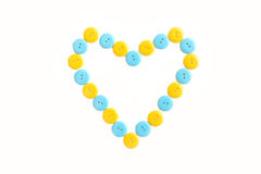 Blue and yellow heart from plastic clasper Royalty Free Stock Photography