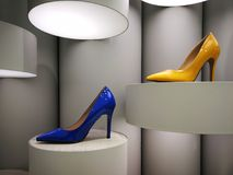 Blue and yellow stilettos on display. Blue and yellow high gloss stilettos on retro display Royalty Free Stock Photography