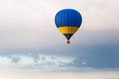 Blue and yellow Hot Air Balloons in Flight Stock Image