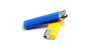 Blue and yellow lighters isolated on the white background Stock Images