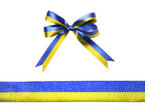 Blue-yellow multicolor fabric ribbon and bow isolated on a white background Royalty Free Stock Photo